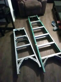 two gray and green metal step ladders