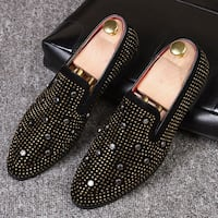 pair of black-and-gold slip on shoes