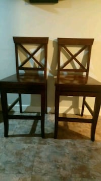 two brown wooden bar stools 502 km