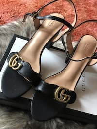 pair of black leather Gucci open-toe heeled sandals size 8 2401 mi