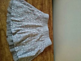 Girl's gray and white floral textile.