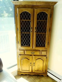 brown wooden framed glass display cabinet Montréal, H2A 1Y4
