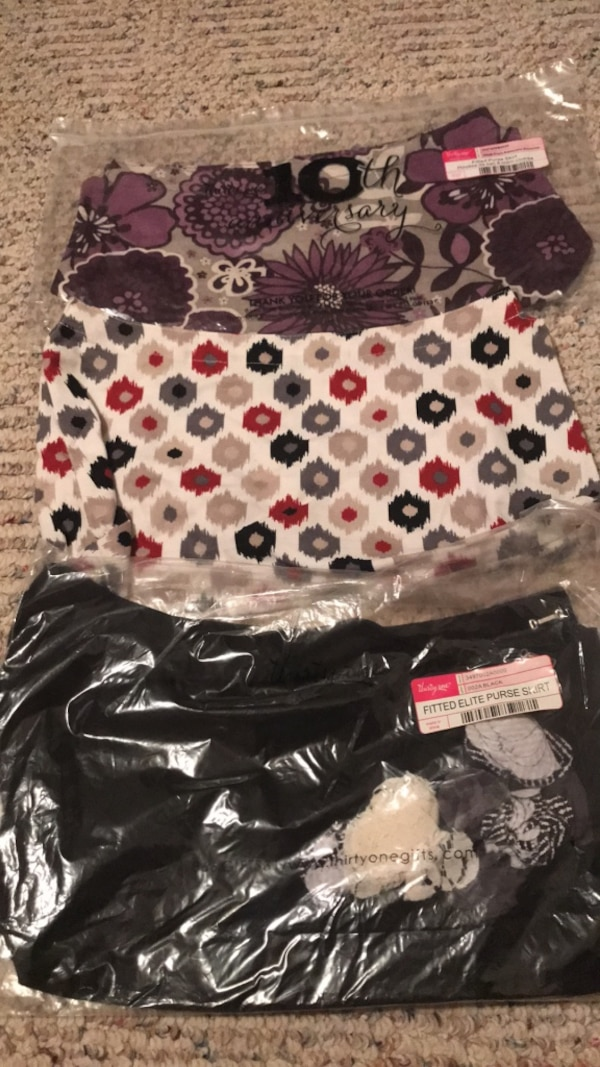 Thirty One purse skirts total of three will sell individually