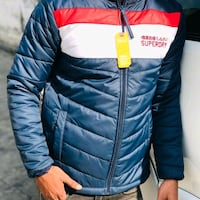 blue, black, white, and red Superdry zip-up bubble jacket Dombivli, 421201