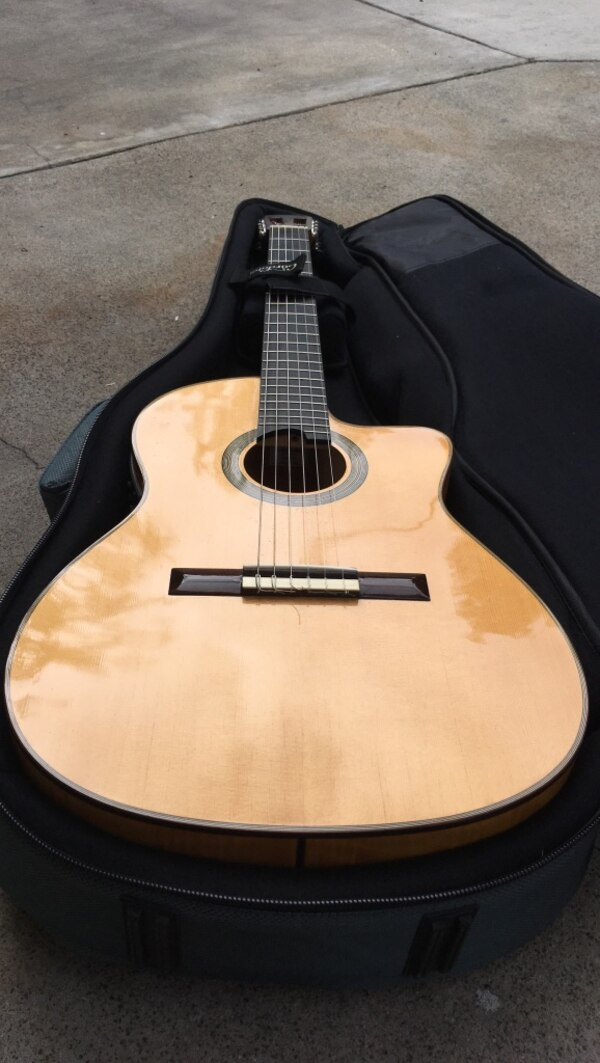 408ddbf7a6e Used Acoustic electric nylon string guitar brand new with travel case for  sale in Costa Mesa - letgo
