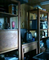brown wooden TV hutch with flat screen television Fresno