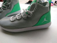 pair of gray-and-green Nike running shoes El Paso, 79928
