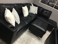 Bonded leather sectional with storage ottoman. Brand new.  1170 mi