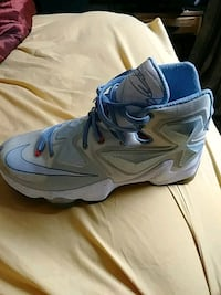 pair of gray Nike basketball shoes St. Louis, 63109