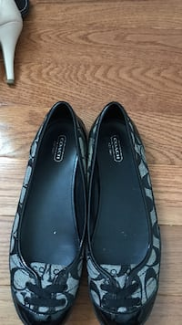 pair of black Coach leather flats
