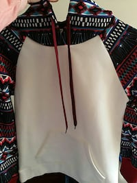 white pullover hoodie with pattern on sleeves