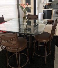 Square glass top table with gray metal base and four bar stools Montréal, H9K 1J5