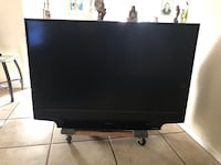 Black flat screen tv with remote Montclair, 91763