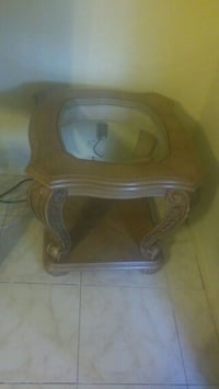 brown wooden framed glass top side table Lauderhill, 33319