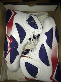 pair of white-and-blue Air Jordan 7 with box