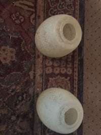 Two cream colored glass globes