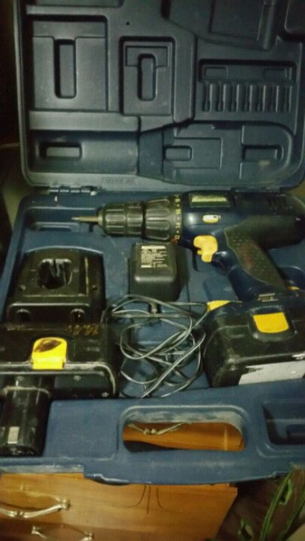 black and yellow cordless power drill