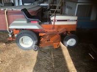 Red and black ride on mower price firm