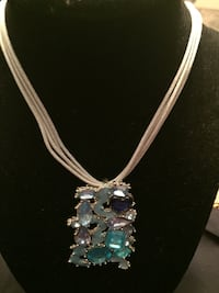 Silver chain necklace with green gemstone pendant