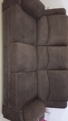 Two grey suede sofa chairs