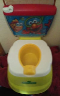 baby's white and green Sesame Street potty trainer Las Vegas, 89130