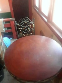 round brown wooden dining table Westmont
