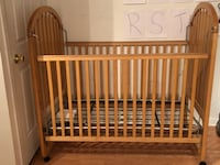baby's brown wooden crib Laval, H7M 2E8
