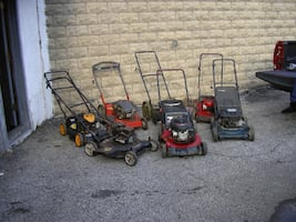(7) SEVEN LAWNMOWERS - ALL NEED WORK - FIX SOME USE SOME FOR PARTS