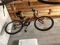 Black and red full-suspension mountain bike 535 km