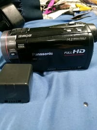 black and gray panosonic DSLR camcorder with charg