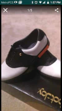 unpaired black and White spikeless golf shoes 693 mi