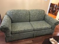 Green fabric 2-seat sofa bed couch
