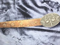 swords embossed silver-colored buckle