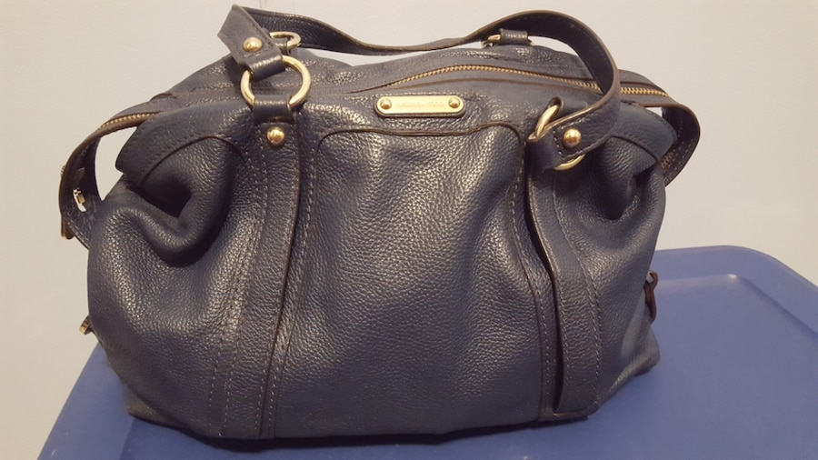 Photo Michael Kors- Blue leather purse with gold handles