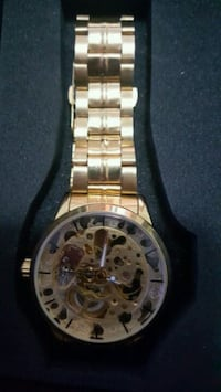 round gold-colored chronograph watch with link bracelet Vancouver, V6S 1S3