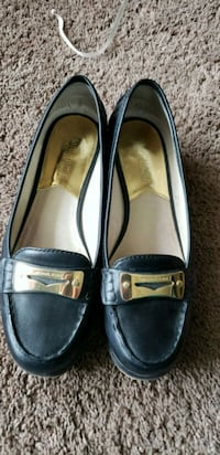 pair of black leather loafers Regina, S4S 6T5