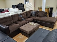 New chocolate microfiber faux leather sectional with pillows and stora College Park