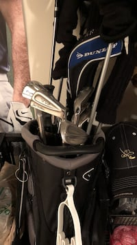 gray and black golf bag with gray golf clubs Hanover, 21076