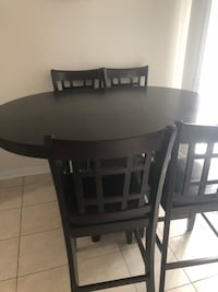 Round black wooden table with four chairs dining set Brampton, L6V 3Z5