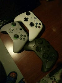 two black and white Xbox 360 controllers Calgary, T2A 5L2