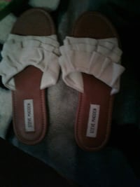 pair of brown-and-white Steve Madden slide sandals Mission