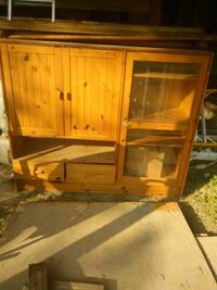 Pine wooden framed glass display case w drawers.