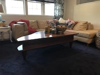 brown wooden framed glass top coffee table Jacksonville, 32207