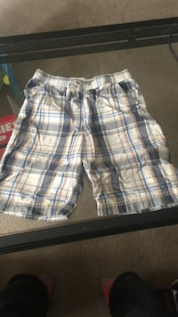 gray, white, brown, and blue plaid board shorts Freeport, 61032