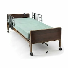 brown wooden bed frame with green mattress