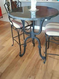 Arhaus Blue Stone pub table and two chairs.  New Orleans, 70112