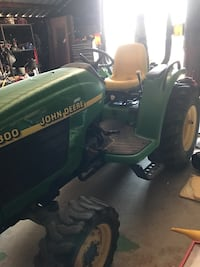 Green and yellow john deere ride on lawn,mower Paradise, 76073