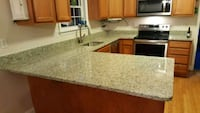 stainless steel faucet and brown wooden kitchen cabinet Silver Spring, 20906