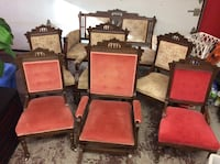 four brown wooden framed red padded chairs
