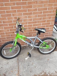 gray and green Next BMX bike